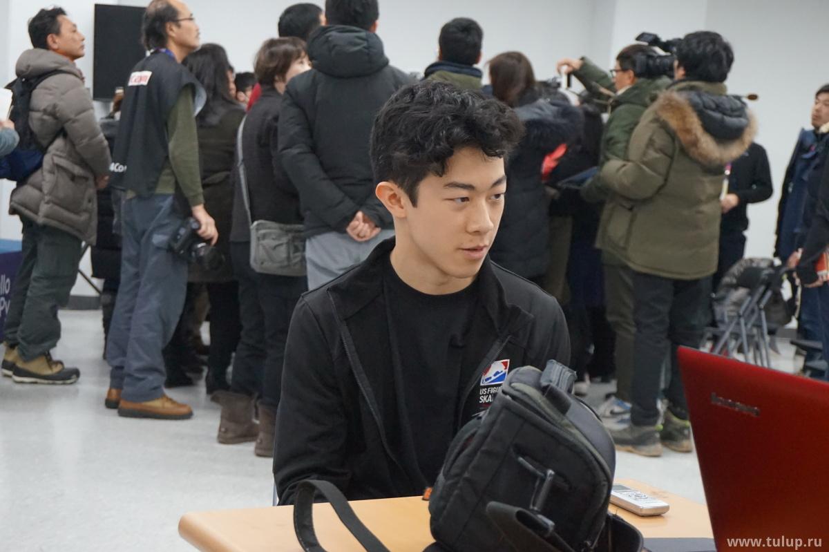 Нэйтан Чень  на фоне толпы японских репортеров