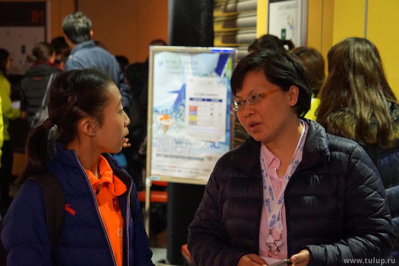 Xiangning Li с тренером Yi